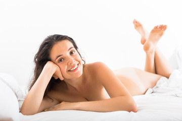 naked woman on bed in bedroom