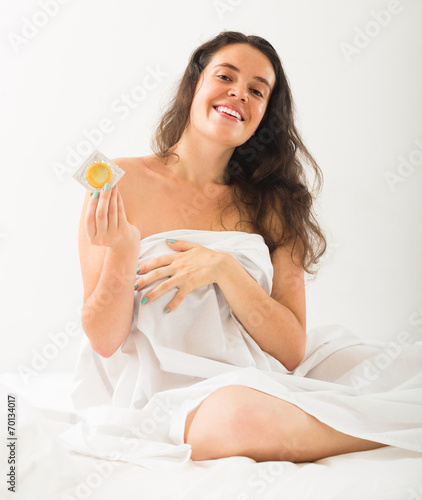 canvas print picture Girl with condom in bed