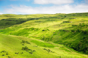 green mountains and meadows Isle of Skye in Scottish Hig
