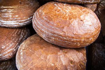 Big pile of freshly baked bread for sale on market