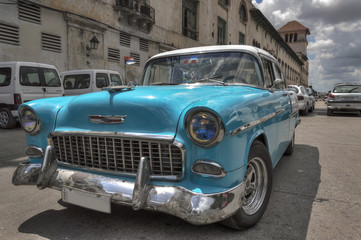 Turquoise old american car in Havana, Cuba