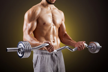 Fitness man lifting weights with curl bar