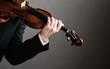 Man violinist holding violin. Classical music art
