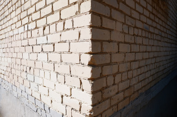 Wide angle view of the corner of a building made of white bricks