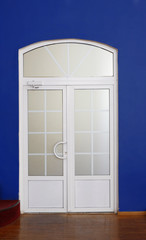 Modern door of white color indoor.