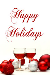 Red Wine and Christmas Decorations with Words Happy Holidays
