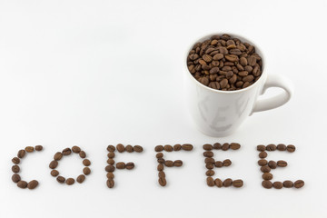 Roasted coffee beans in a cup with name on white background
