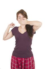 Beautiful young girl student teenager wearing purple pyjamas
