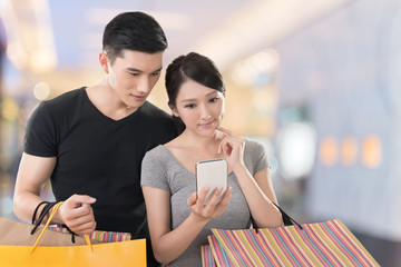 shopping and looking at cellphone