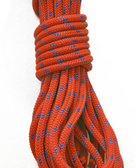Braided rock climbing rope in coil
