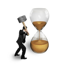 man holding hammer to hit hourglass