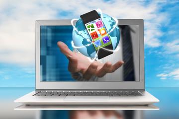 smartwatch and glowing orbit globe in hand through laptop