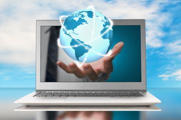 glowing orbit globe in hand through laptop