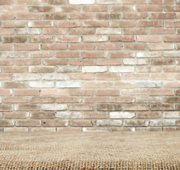 Sackcloth over table and brick wall, background, template