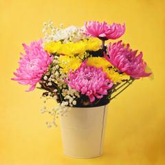 Flower boquet on yellow background