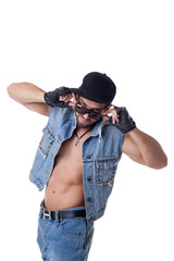 Funny man posing in denim suit and sunglasses
