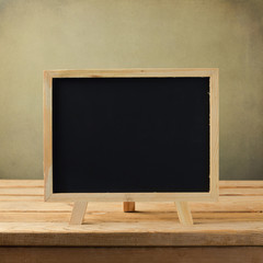 Chalkboard on wooden table