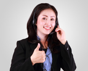 Attractive business woman smiling with headset