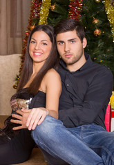 beautiful young couple in romantic Christmas night