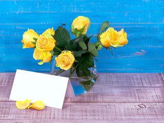 Roses in a vase and a postcard with space for text