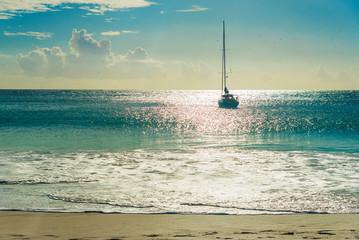 Yacht at beach at sunset. Anse Georgette, Praslin , Seychelles