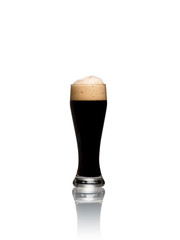 Glass of stout beer isolated on a white background
