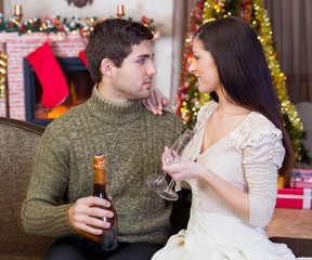 young romantic couple celebrate Christmas night