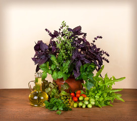 Still life with basil, celery, dill and tomatoes cherry