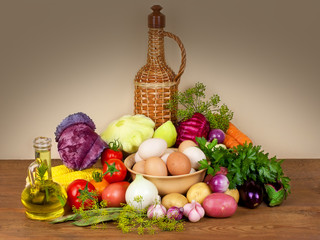 Still life with vegetables, herbs, eggs and oil