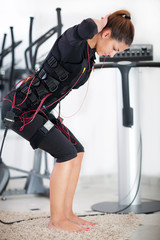 young woman exercise on electro stimulation machine