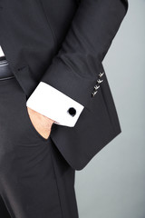 Man in black suit on grey background