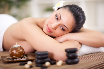 beautiful woman relaxing in spa center