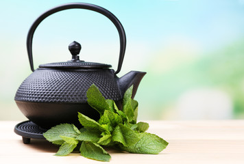 Chinese traditional teapot with fresh mint leaves