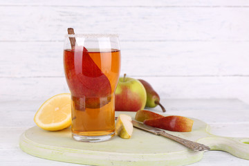 tasty summer drink with fresh fruits, on wooden table