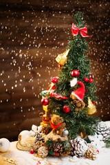 Christmas still life with teddy bears decorating tree