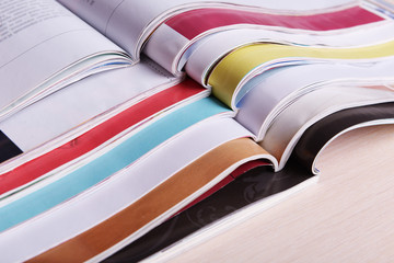 Magazines on wooden table close up