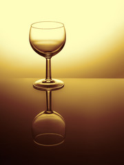 Wine glass reflected. Empty. Fitered image, golden.