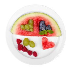 Fresh juicy watermelon slice  with cut out heart shape, filled