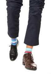 Man leg in suit and colorful socks, isolated on white
