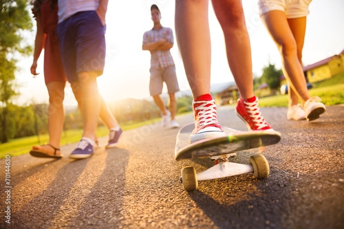 canvas print picture Young peoples legs with skateboard