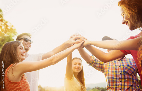 canvas print picture Friends with hands in stack