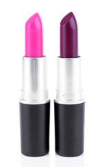 Crimson and cherry blossom lipsticks isolated on white