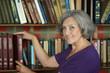 Leinwanddruck Bild - Beautiful elderly woman with book