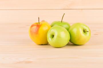 Fresh green apples on wood.