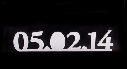 Date on a black background.