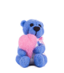 Soft toy teddy with heart.