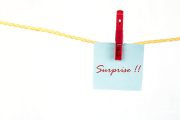 Note colored paper with the word surprise