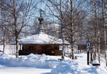 Winter country, wooden old chapel