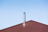Metal chimney on the roof