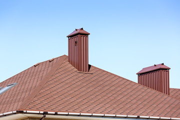 New tiled roof with chimneys